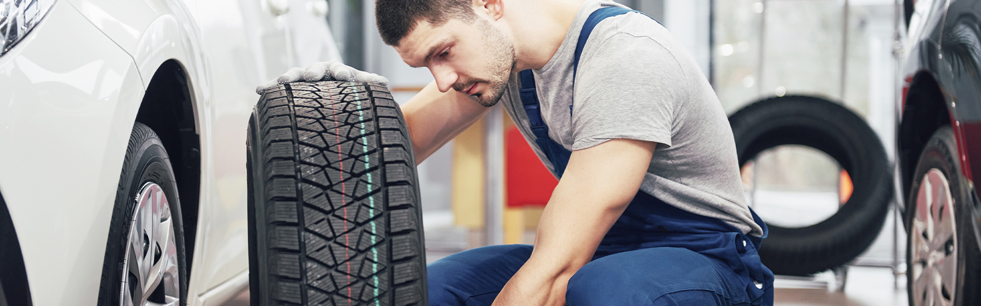 Washington Hyundai is a Hyundai Dealership in Washington near Canonsburg PA | Service Advisor Changing Tire on Vheicle