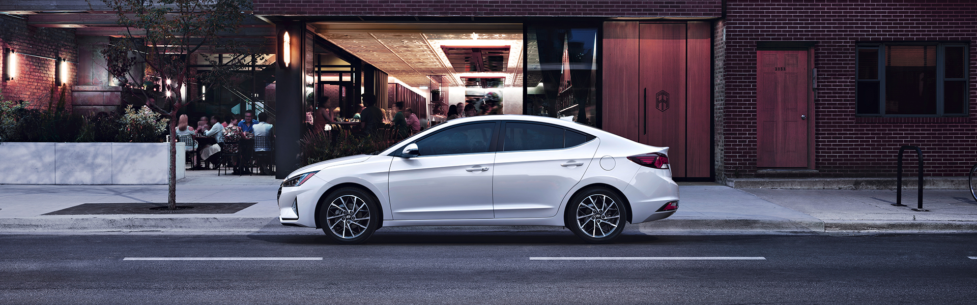 Washington Hyundai is a Hyundai Dealership in Washington near Canonsburg PA | White 2020 Elantra Street Parked in City